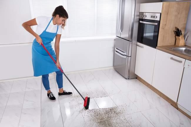 clean tile floors using a broom