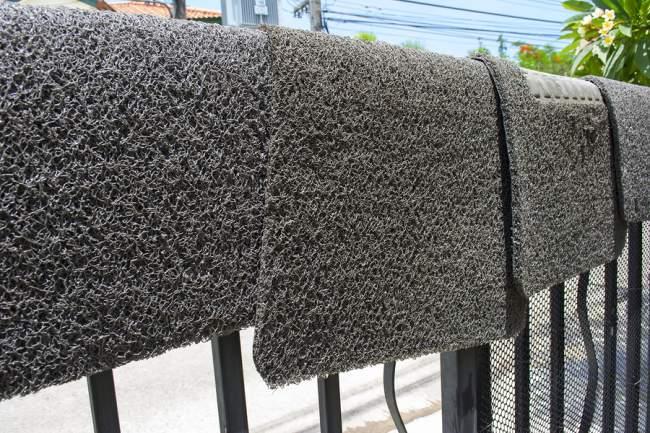 car mats hanging on a rack