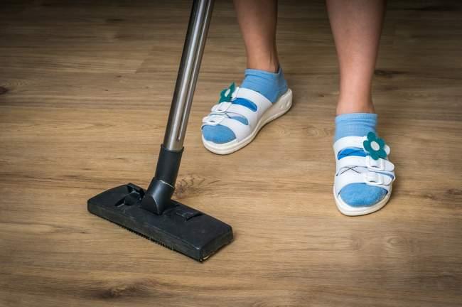 vacuuming laminate floor